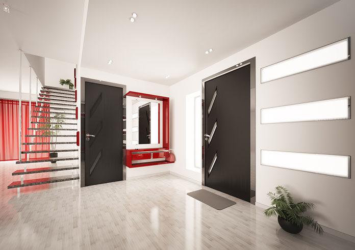 Czarne drzwi wewnętrzne – pomysł na nowoczesne wnętrze lokalu użytkowego i mieszkania